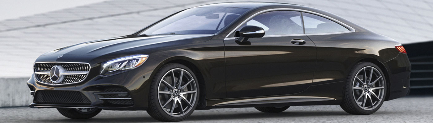 Side angle of a black S-Class Coupe