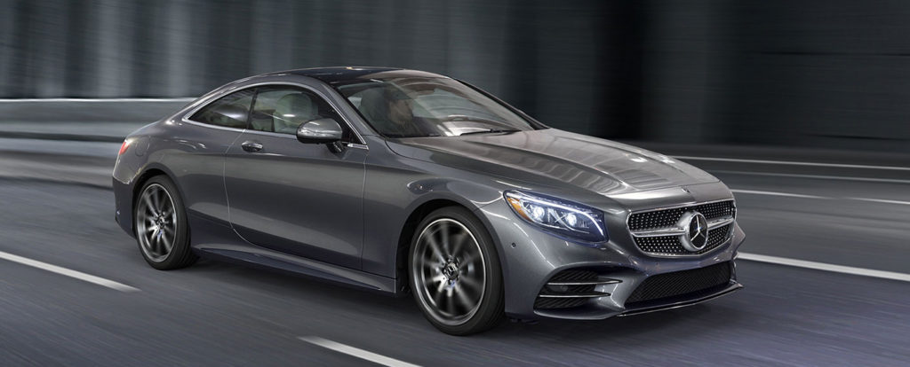 Front side view of a Steel Grey S-Class Coupe Driving on a empty road