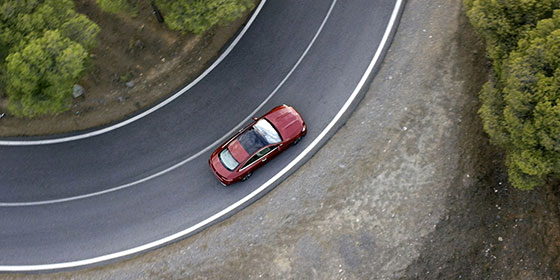 Top view of a 2019 E-class coupe on a  curved road