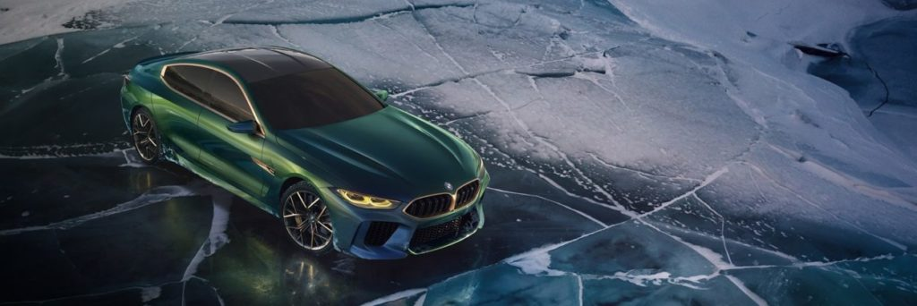 BMW Concept M* posing on the ice in  dark green