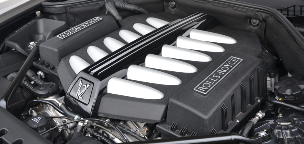 Warsaw, Poland - 6th March, 2014: Look on the V12 engine in a Rolls-Royce limousine on the parking. The Rolls-Royce is powered by V12, 6,6-litre petrol engine (pushing out 570 HP/780 Nm).