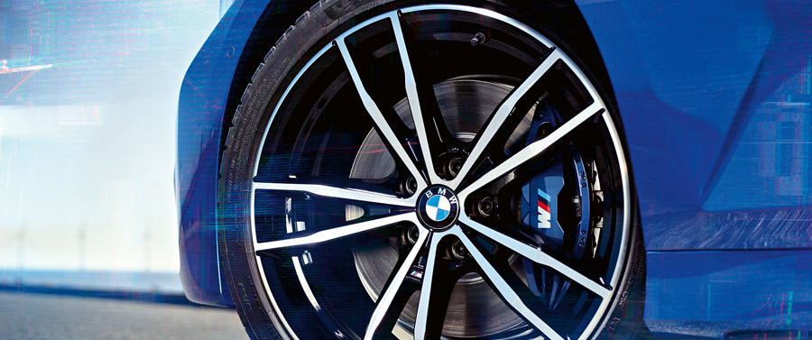 Close-up of 19'' M light alloy wheels 791 M Jet Black of the BMW 3 Series Sedan.
