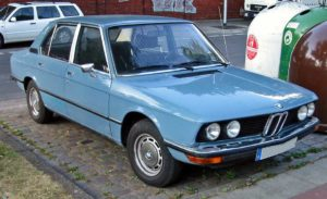first generation BMW 5 Series in light baby blue