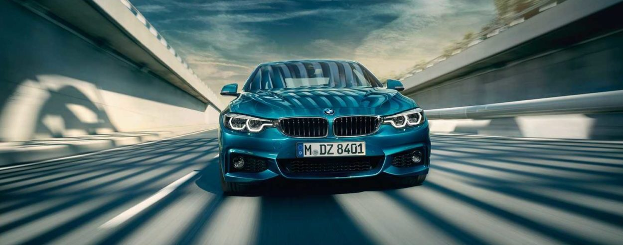 BMW 4 series in teal blue front view