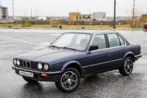 Novyy Urengoy, Russia - June 16, 2013: Blue motor car BMW E30 324d in the city street.