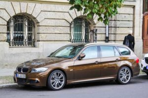 BERLIN, GERMANY - SEPTEMBER 12, 2013: Motor car BMW E91 3-series at the city street.