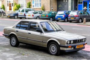 ROTTERDAM, NETHERLANDS - AUGUST 9, 2014: Motor car BMW E30 3-series in the city street.
