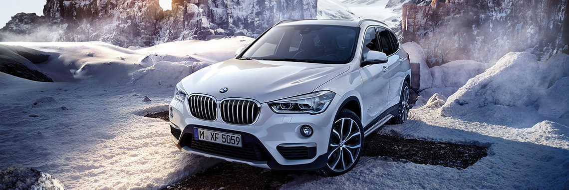 BMW X1 in front of a snowy landscape