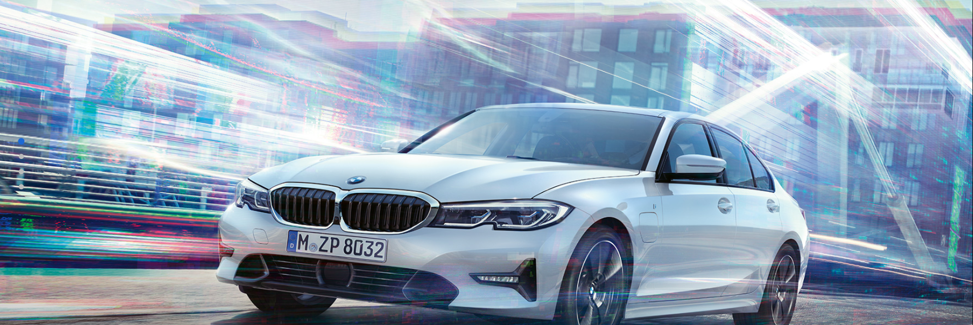 BMW 3 Series driving in the city with a futuristic design