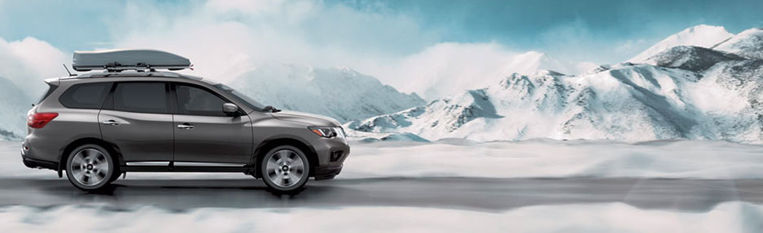 Nissan Pathfinder® Platinum shown in Gun Metallic with optional equipment highlighting roof rails.