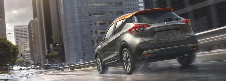 2019 Nissan Kicks driving away into the city