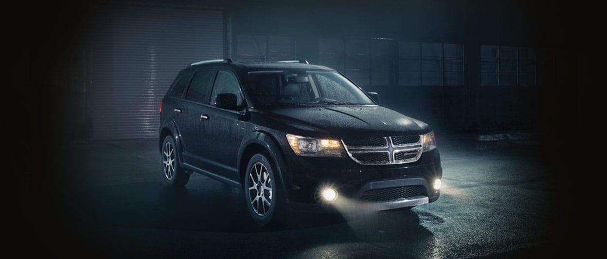2018 Dodge Journey in the rain with headlights on