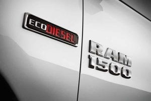 The logo for the EcoDiesel engine on a RAM 1500 truck