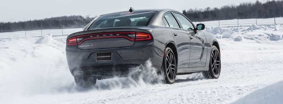 2019 Dodge Charger rear view of exterior, shown in silver in the snow