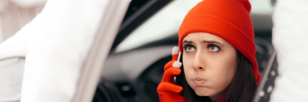 A woman calls for help after a winter breakdown