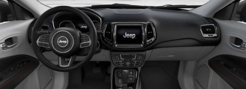 view of the front seats and dashboard of the 2019 Jeep Compass