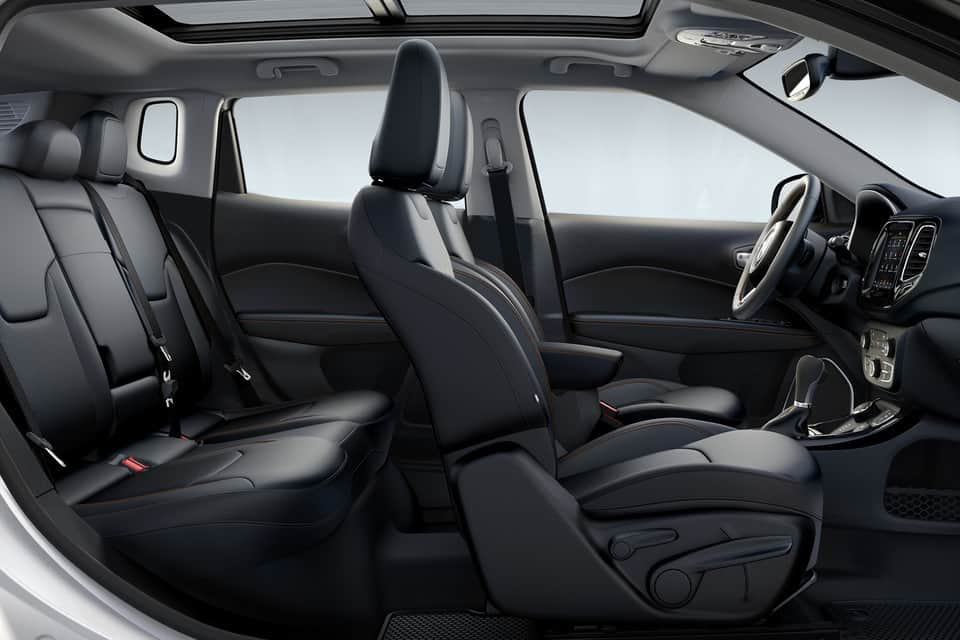 Black leather interior of the 2019 Jeep Compass Trailhawk with red accent stitching