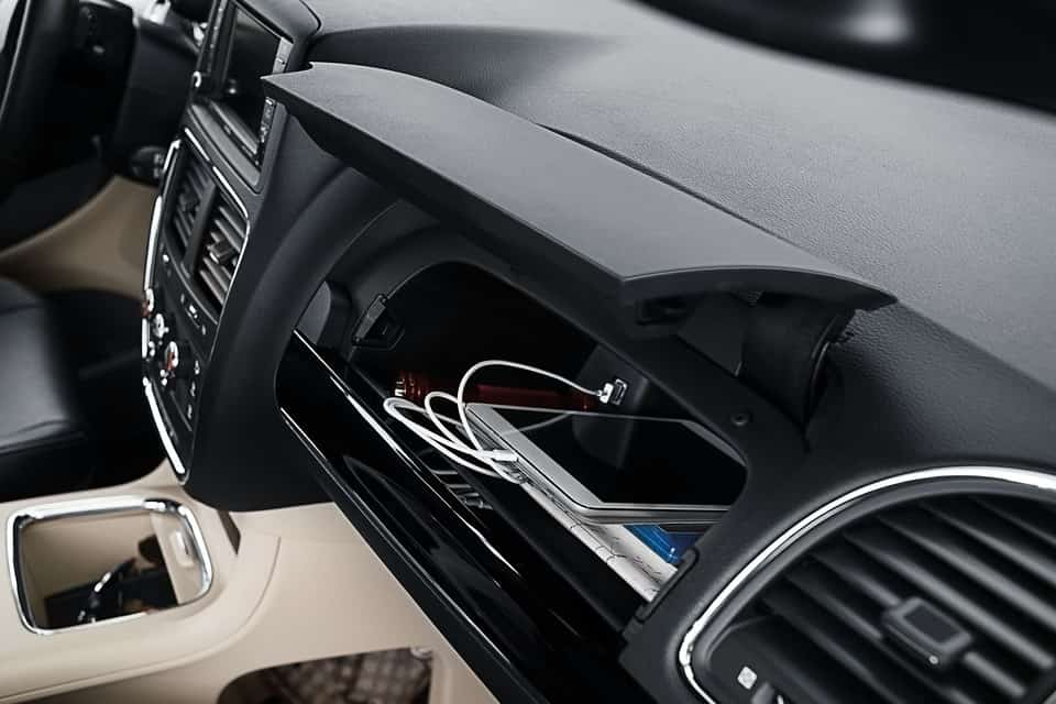 Glove compartment of the 2019 Dodge Grand Caravan with a tablet plugged inside