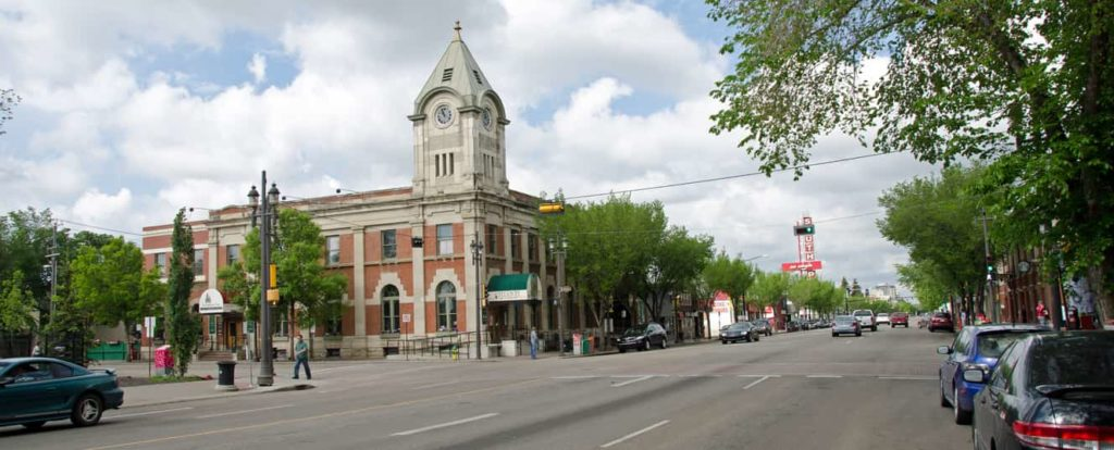 Looking east down Whyte Avenue in the Old Strathcona region in Edmonton Alberta.The building is the old post office and is now a restaurant. This avenue runs into the Alberta University district and it as a popular street for student shopping and entertainment.