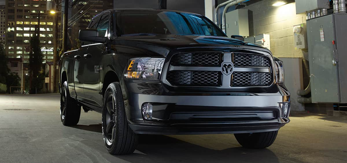 The 2019 ram 1500 Classic photographed at night showcasing the classic crosshaired grille