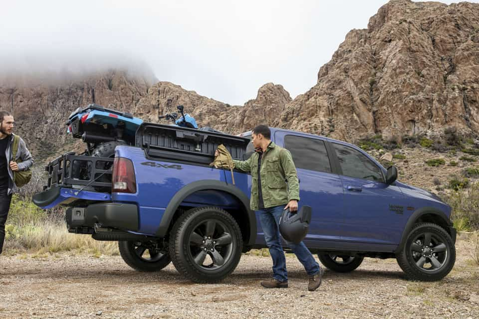 2019 Ram 1500 Classic in blue parked in the middle of a rocky mountain