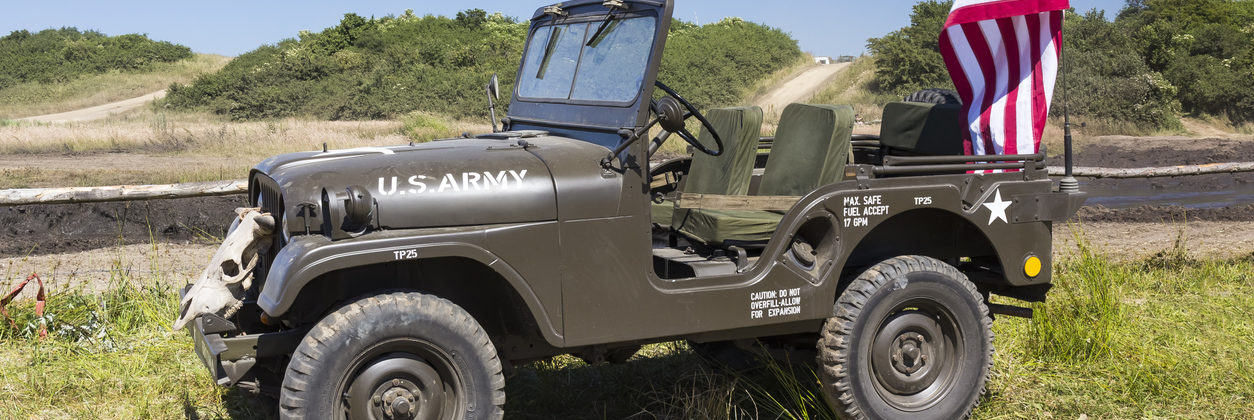 Old WWII US Army Jeep with US flag