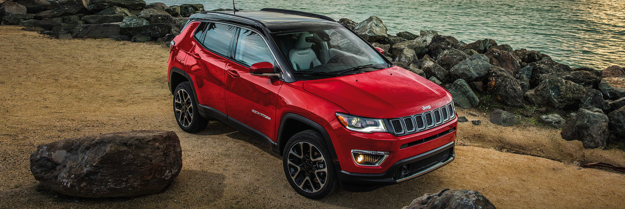 2020 Jeep Compass parked by a rocky shore