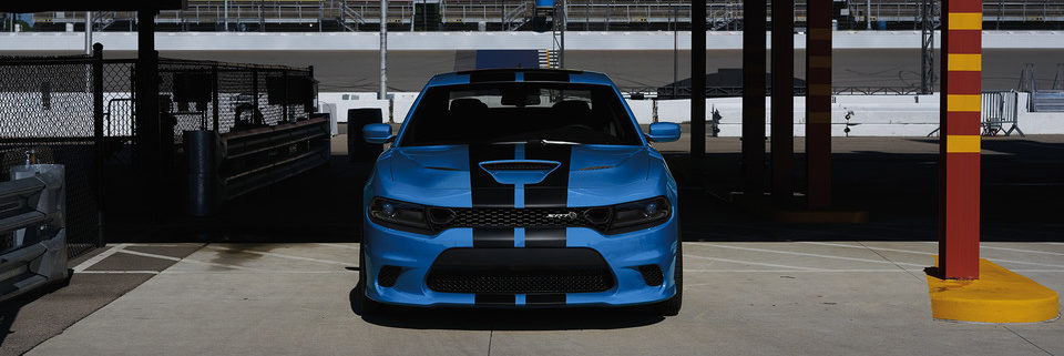 2019 Dodge Charger front profile parked on a speedway