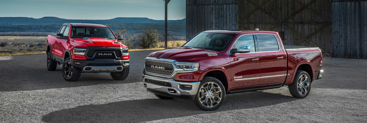 2020 Ram 1500s parked nexted to each other by a barn