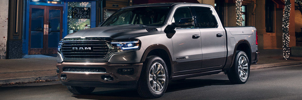 2020 RAM 1500 shown in silver parked on street during holiday season