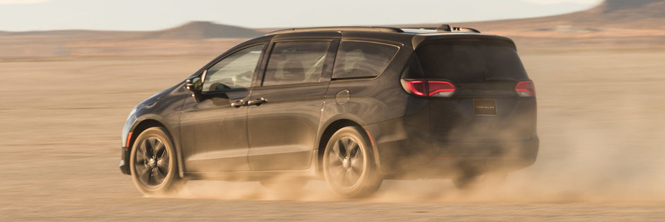 2020 Chrysler Pacifica kicking up dust in a desert