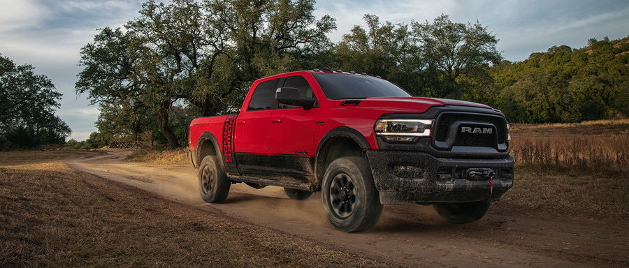 2020 Ram 2500 driving on a dirt road
