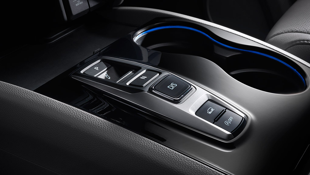 A closeup on the gear-shifter in the cabin of a 2019 Honda Pilot