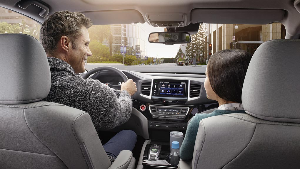 A father and daughter enjoy the smooth ride in a 2019 Honda Pilot