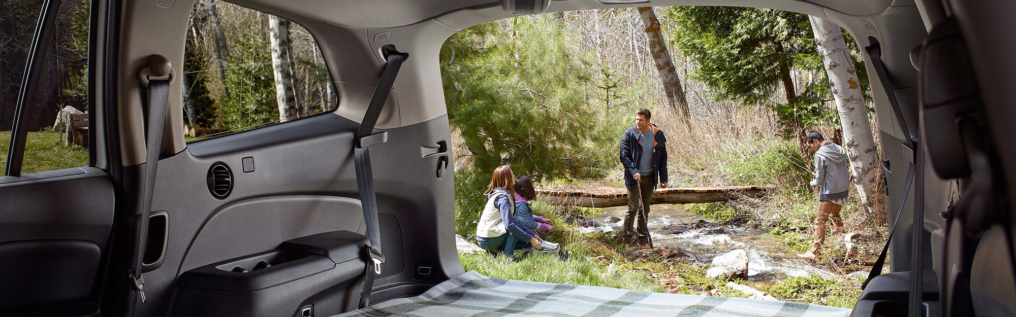 We peer out the back of an open 2019 Honda Pilot at a family enjoying the great outdoors.