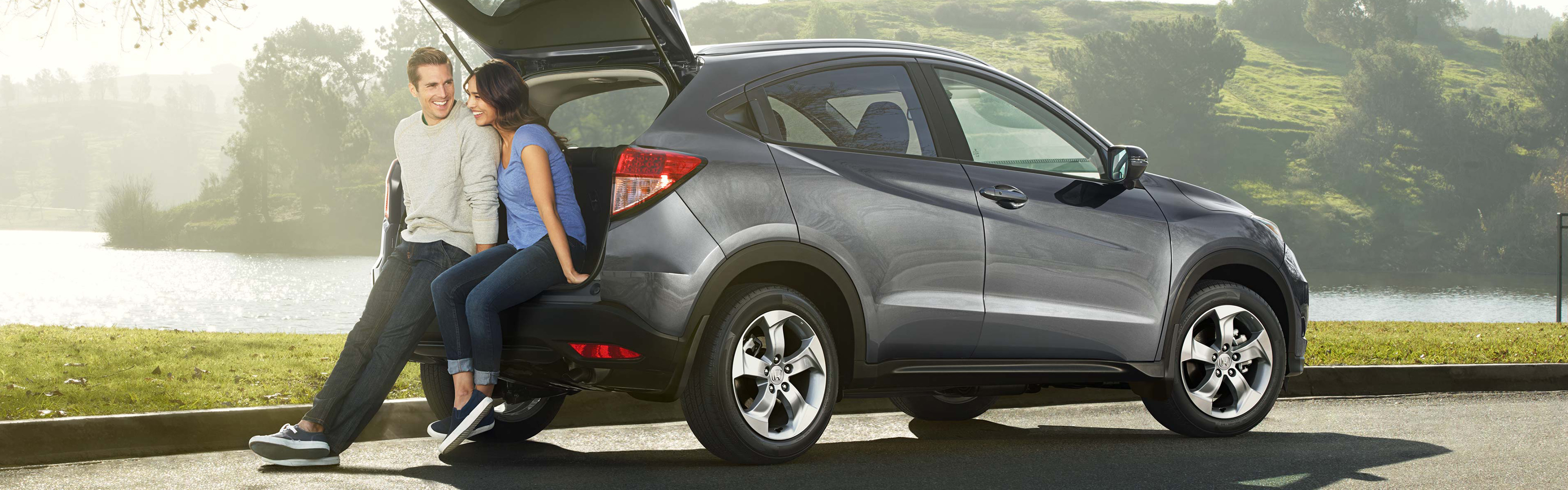 couple sitting in the trunk of a 2019 honda cr-v