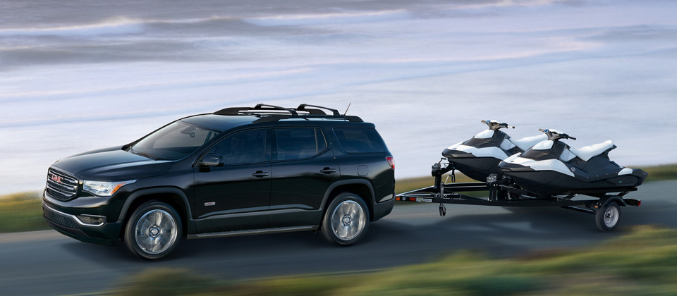 A 2019 CMG Acadia tows a trailer to the lake
