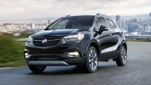 The sleek, 2019 Buick Encore driving away from the city and into adventure