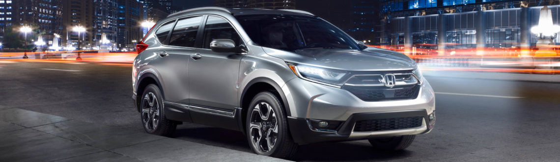 The sleek and stylish 2019 Honda CR-V, driving down a night-time city street
