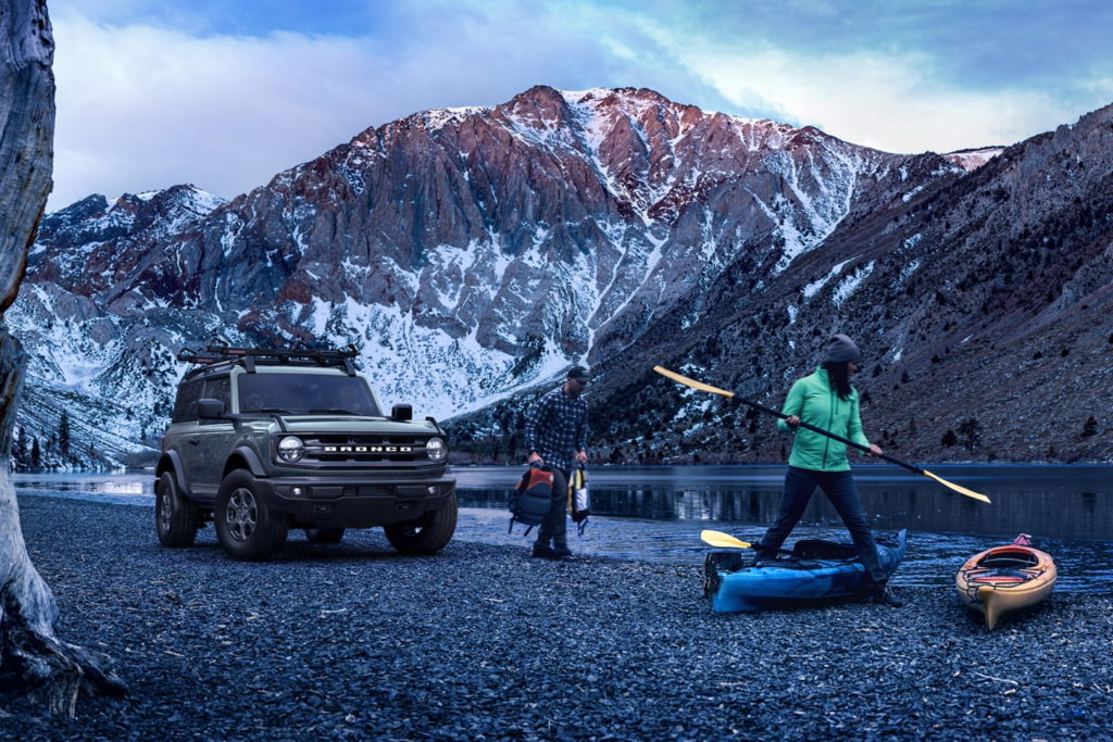 2021 Ford Bronco parked by mountain side shore