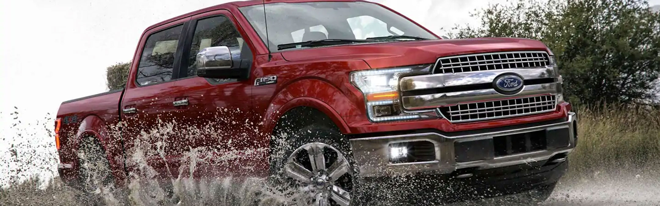 F 150 4 by 4 going through wet off road terrain