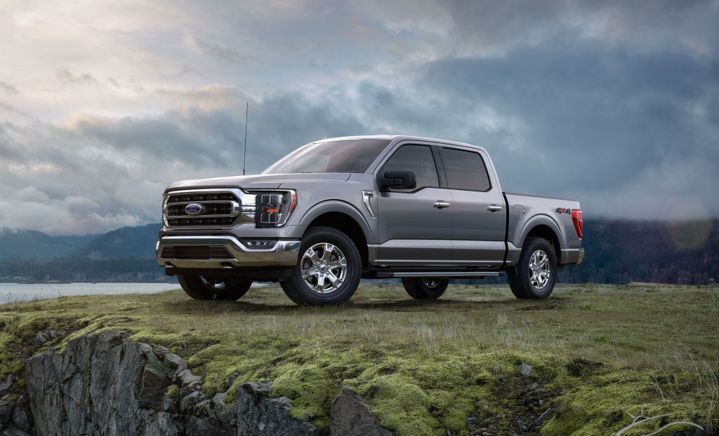 Side exterior view of the 2021 Ford F-150 parked on grass at the top of a hill