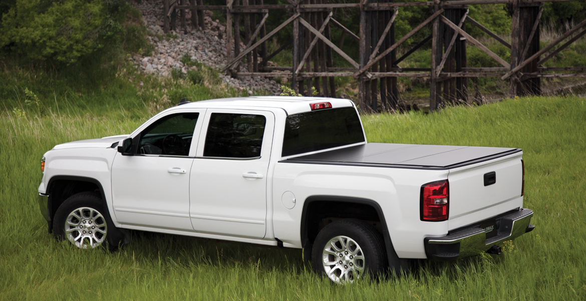 Gmc Displayed With Lomax Hard Tonneau Cover At Pro Truck In