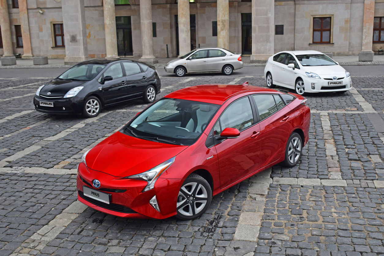 Four generations of Toyota Prius vehicles in a circle