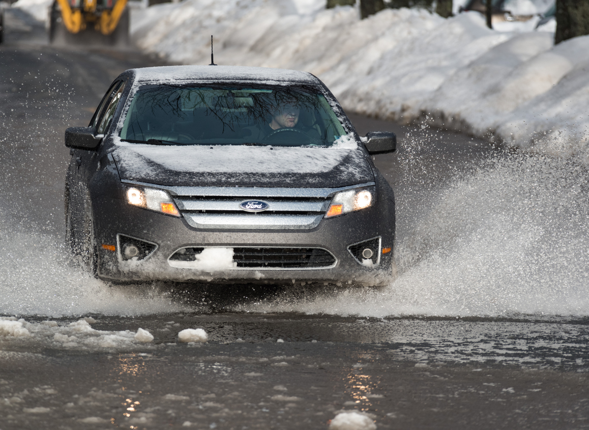 ford driving through slushy conditions