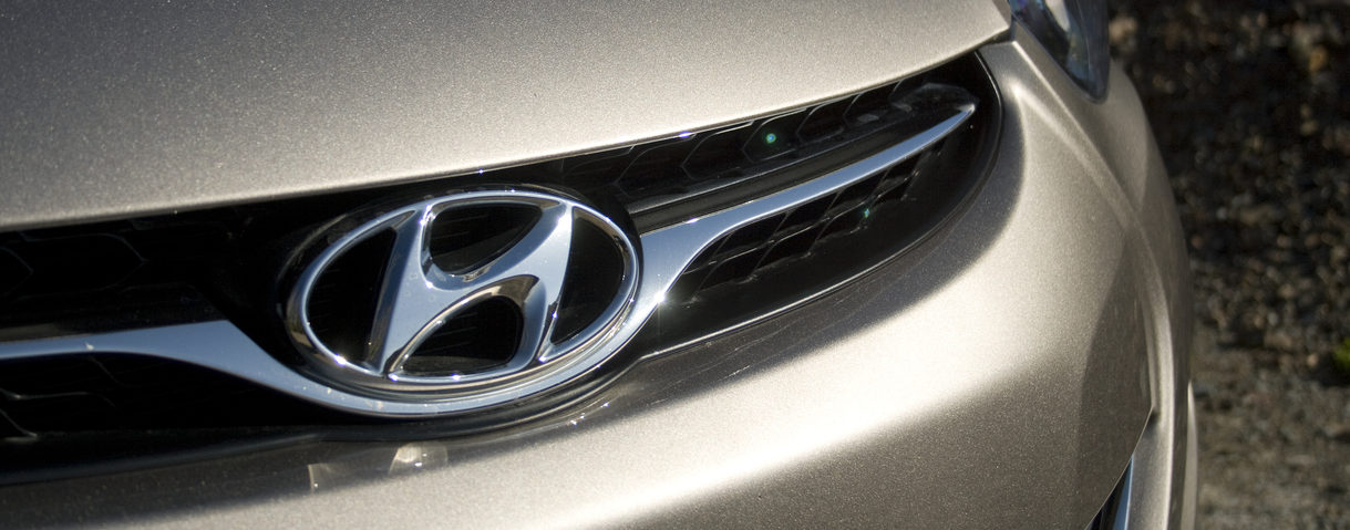 Hyundai Elantra logo on a car