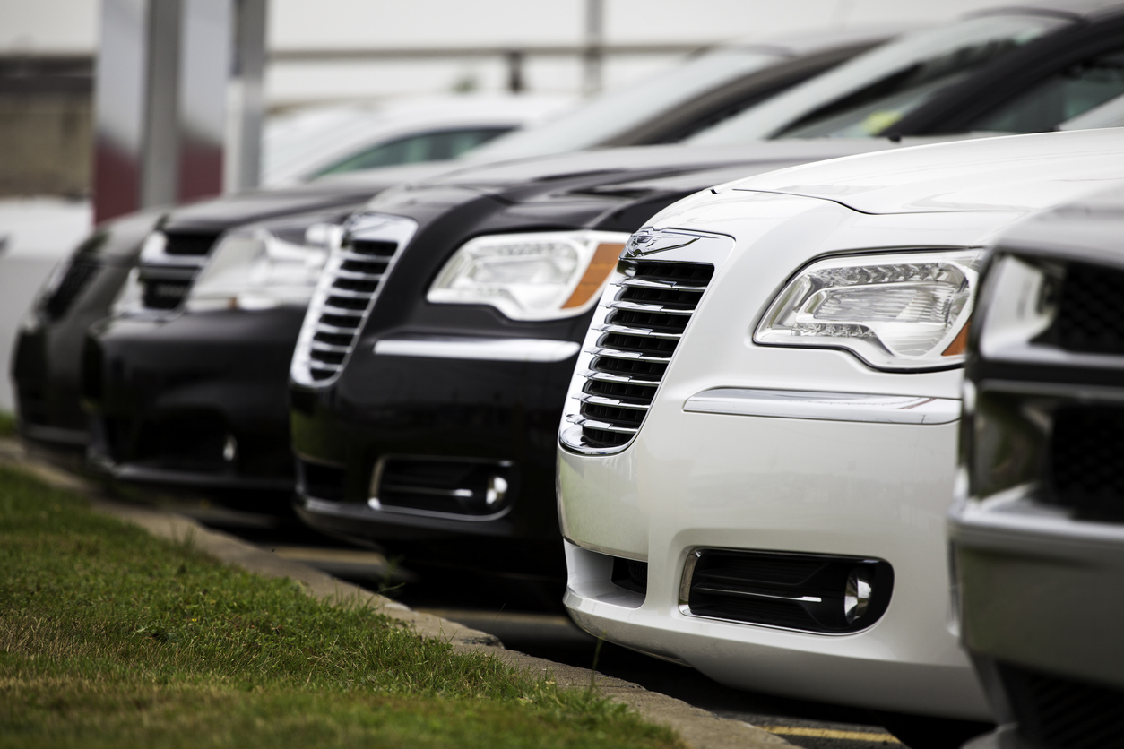 Dodge and Chrysler Vehicles in a Row at Car Dealership