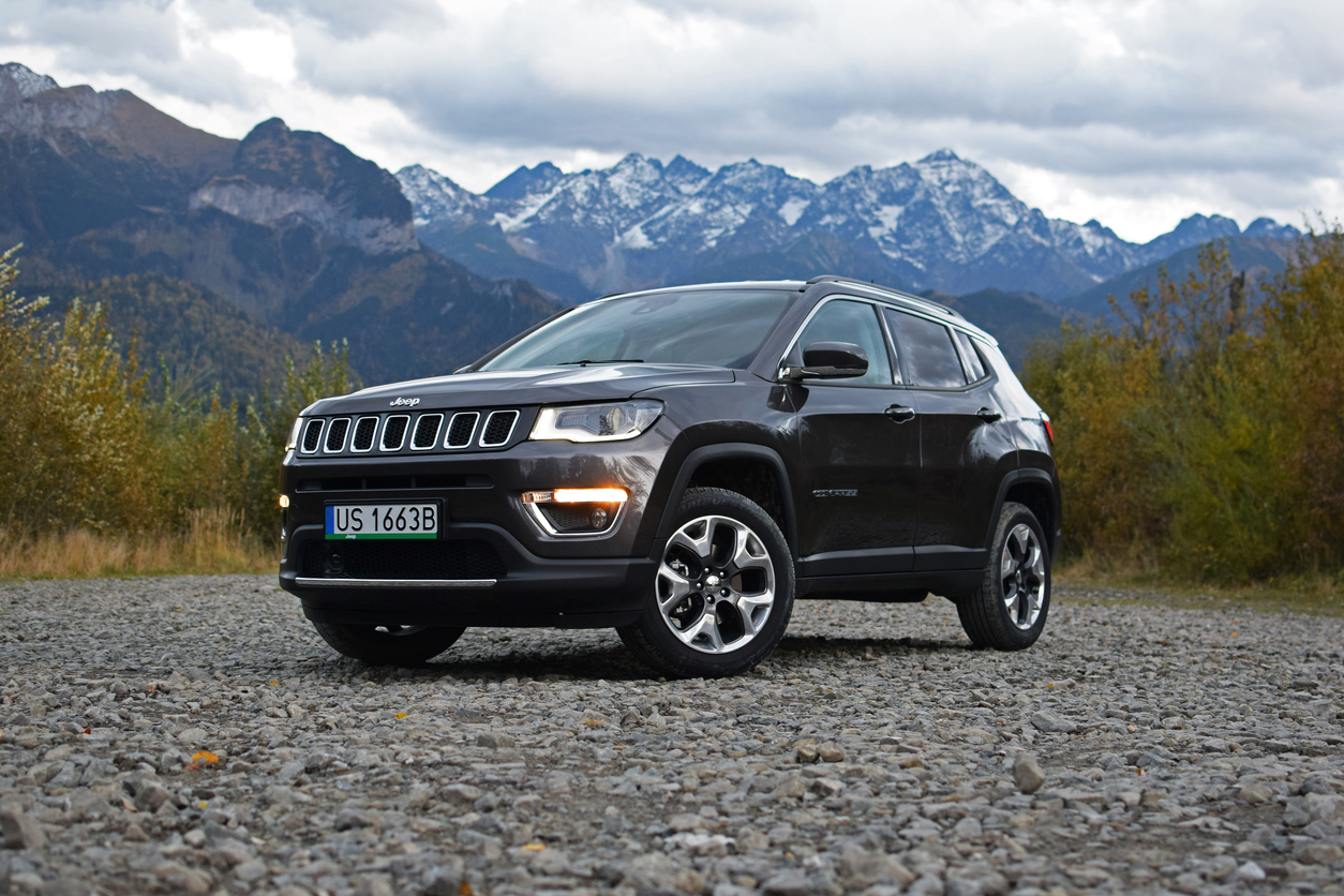 Jeep Compass in front of mountains