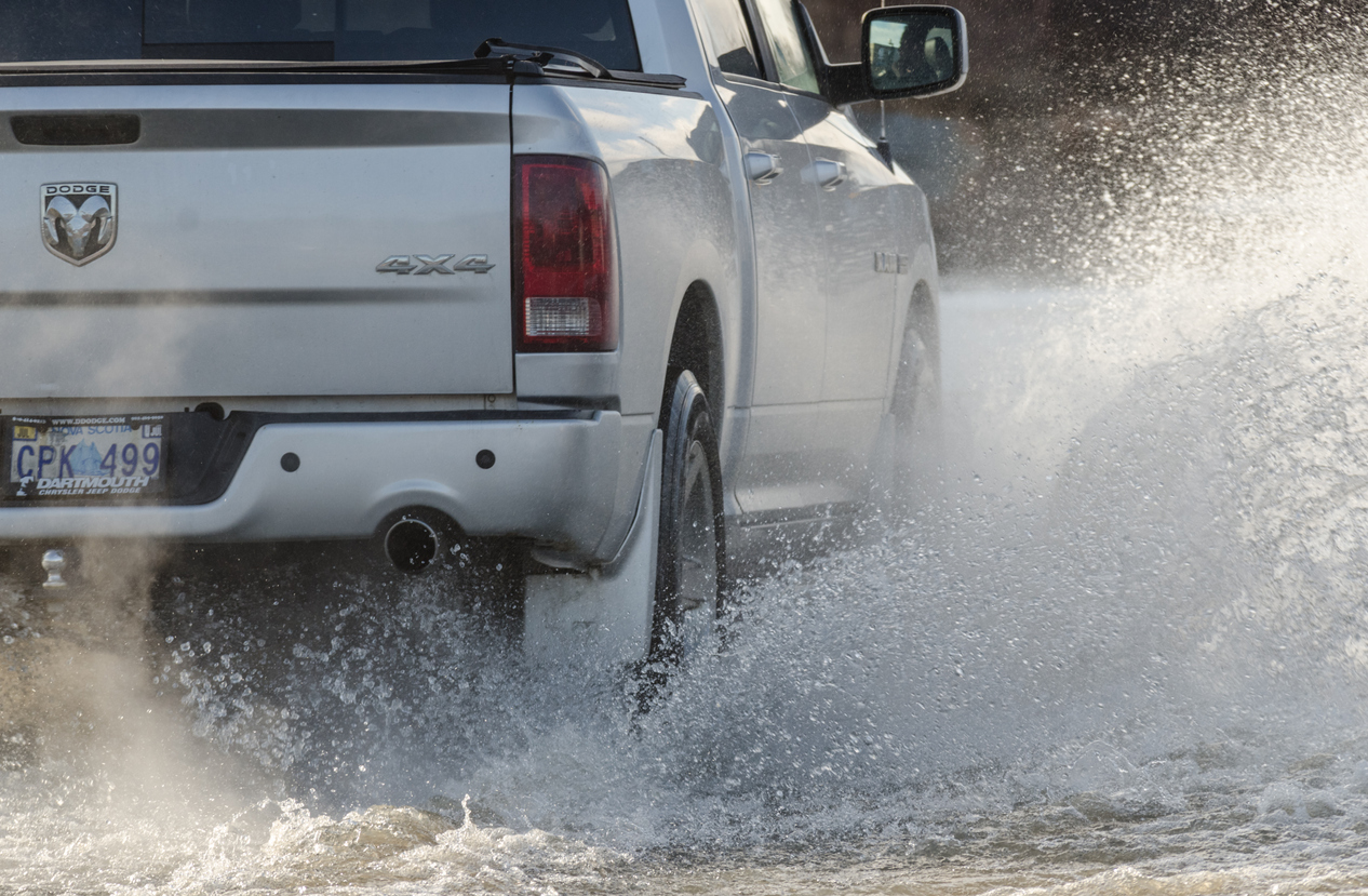 Ram truck driving in flood waters
