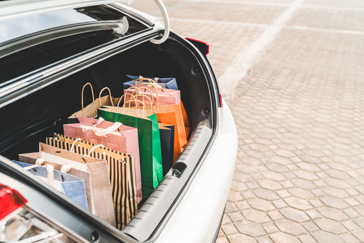Shopping bags in car trunk
